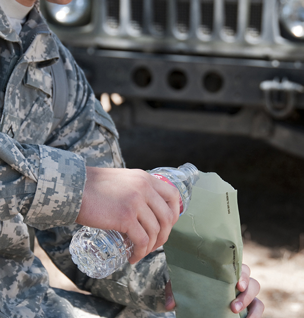 itock image of soldier eating MRE